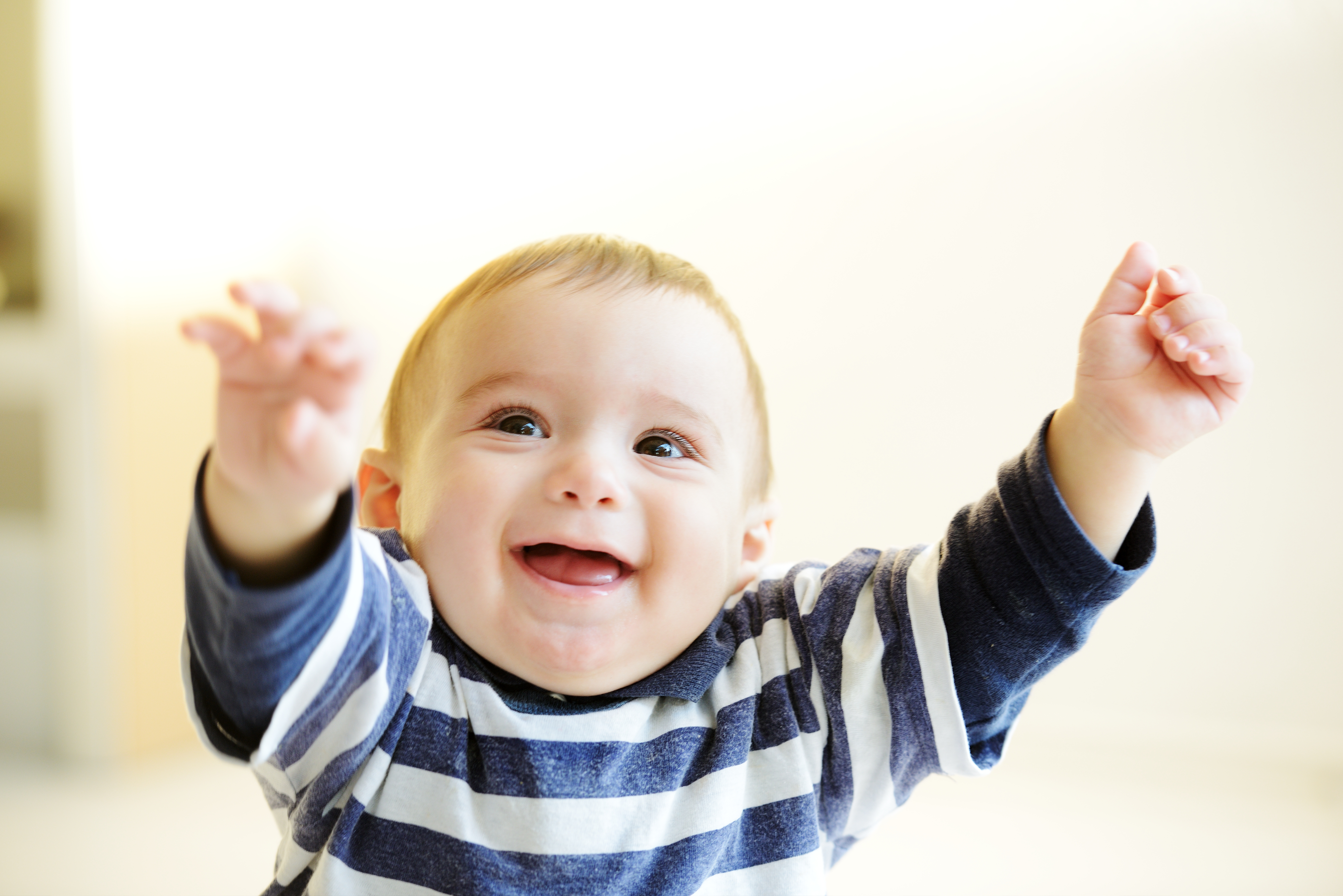Beautiful smiling cute cheerful baby giving you hands