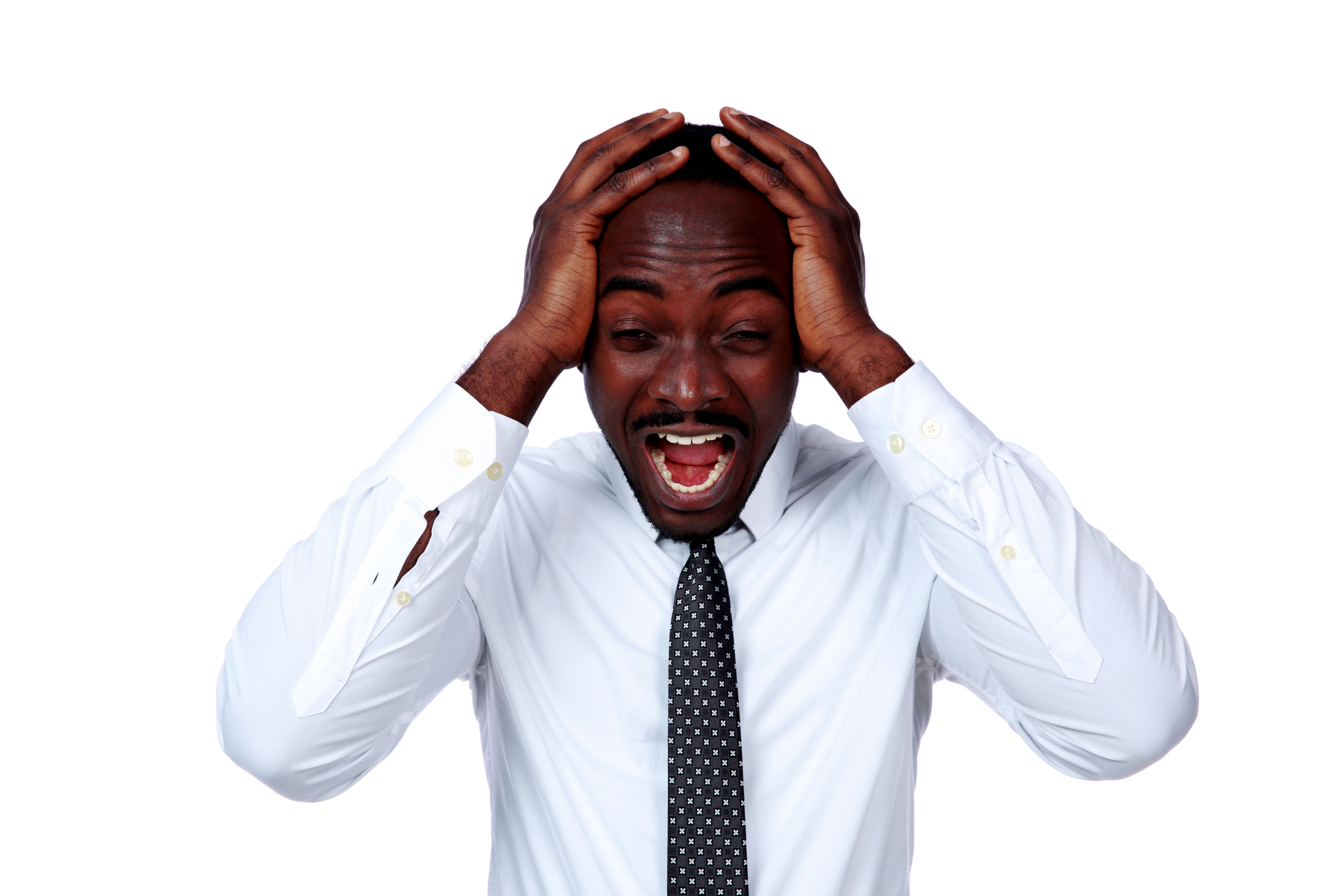 Portrait of a crazy african businessman shouting and closing ear by his hands on white background
